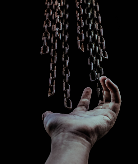 Chains dangling into an open palm